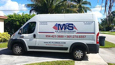 M&S Air Conditioning & Appliance Services Deerfield Beach FL Truck outside residence